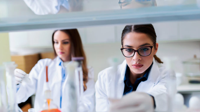 Young female researchers conducting laboratory test.