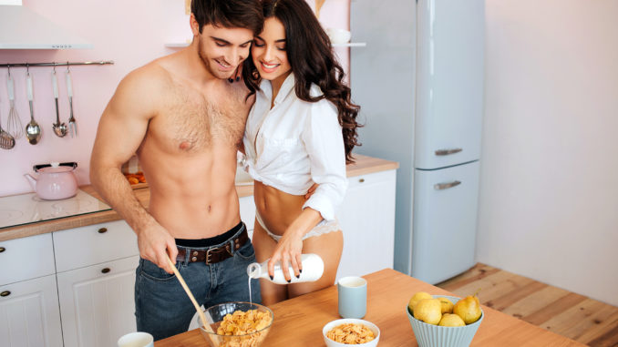 Happy hot couple together in kitchen