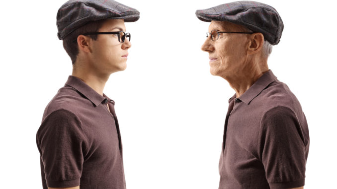 Old men looking at his younger self isolated on white background