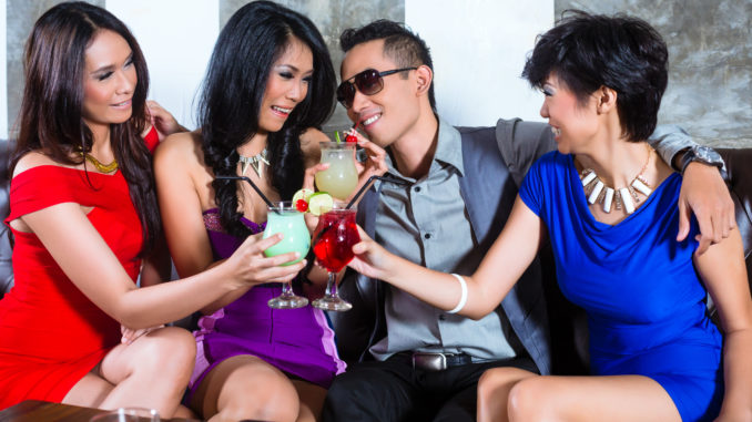 Asian young and handsome party people men flirting with women in fancy night club