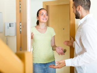 Happy smiling women meeting men at the door