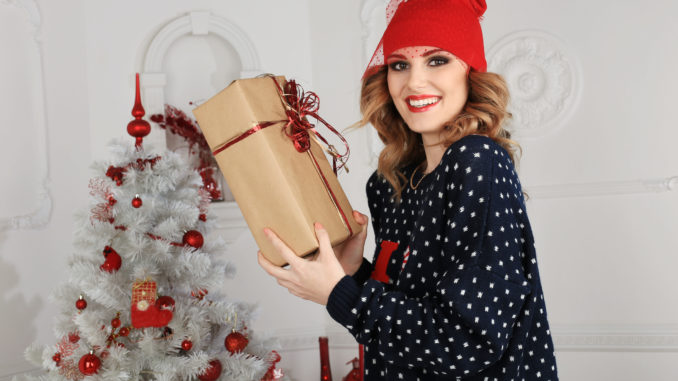 Beautiful woman gives a gift Christmas theme