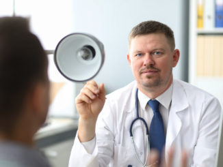 Doctor listening to the patient while he is telling about his problems. Just hands over the table.