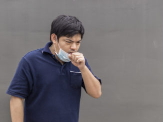 Asian man in the street wearing protective masks., Sick man with flu wearing mask