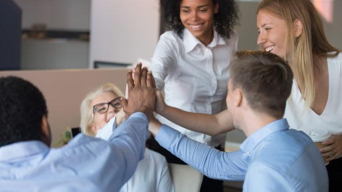 Rewarding advancement, team spirit and support concept