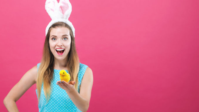 Young woman with Easter theme on a pink background