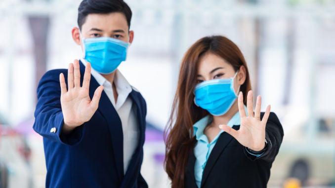 [Covid-19] Coronavirus concept.man and women wearing mask for protect pm2.5 and show stop hands gesture for stop Covid-19 outbreak.Wuhan coronavirus and epidemic virus symptoms.