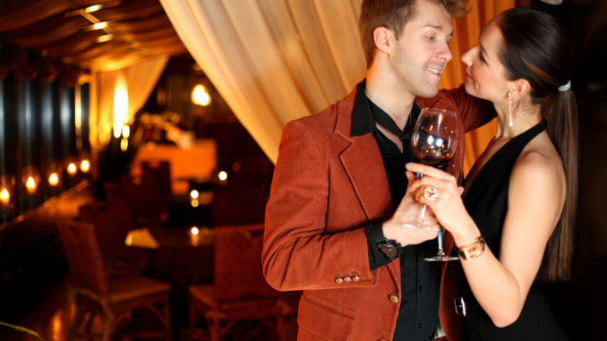 To good girl flirting young men with a glass of wine