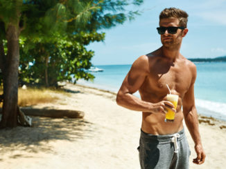 Healthy Drink. Handsome Fitness Male Model Having Fun