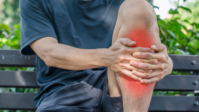 Man with knee pain and feeling bad at park