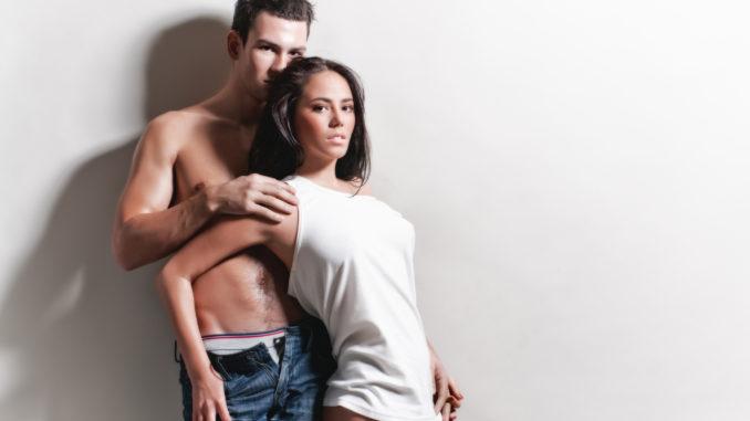 Man and woman posing and looking at the camera