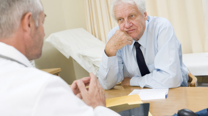 Man in doctor s office frowning