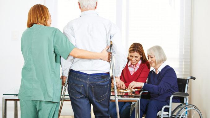 Senior people in nursing home with geriatric garegiver