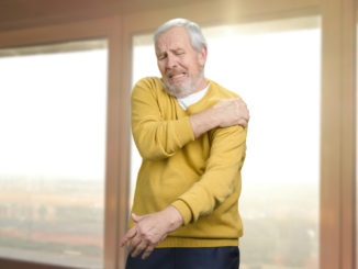 Old senior man with shoulder pain.