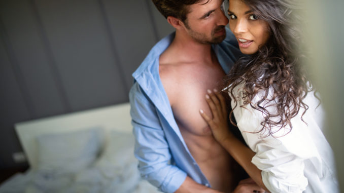 Young hot couple in love hugging and kissing.