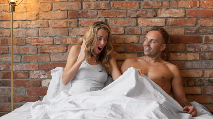 Woman aroused by her men in bed