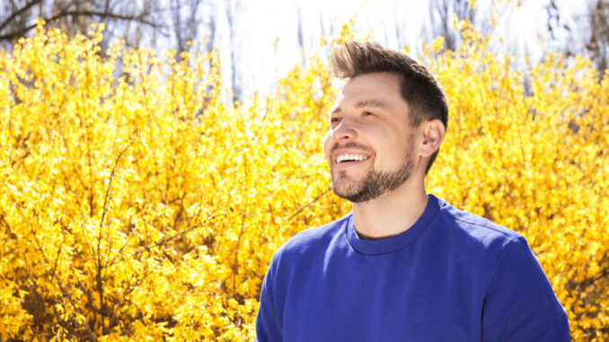 Happy healthy man enjoying springtime outdoors