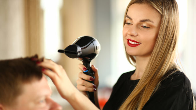 Woman Hairdresser Drying Male Hair with Hairdryer.