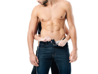 cropped view of woman unzipping pants on man from behind isolated on white