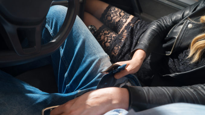 Intimate couple in car