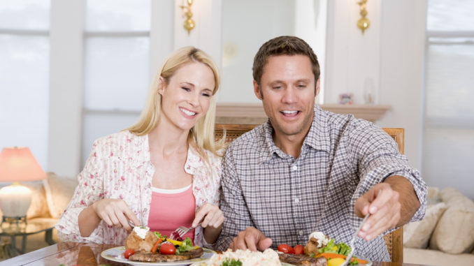 Couple Eating meal, mealtime Together Smiling