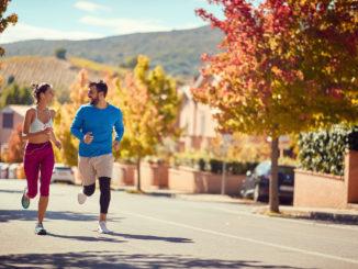 Smiling couple enjoying at jogging at city