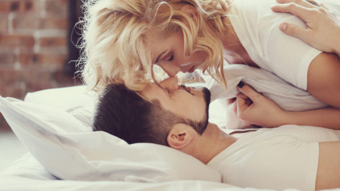 Lifestyle. Beautiful couple in bed