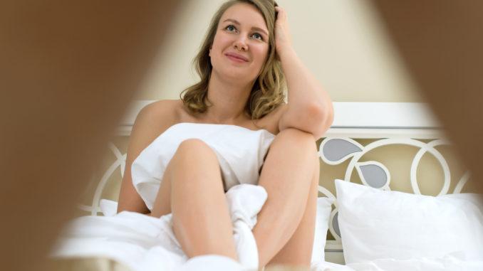 Attractive women looking between man`s legs.