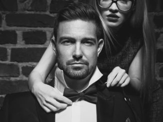 Woman tie bow for man in tuxedo black and white