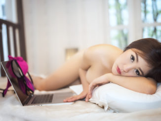 Women using laptop and her relaxed at her bed