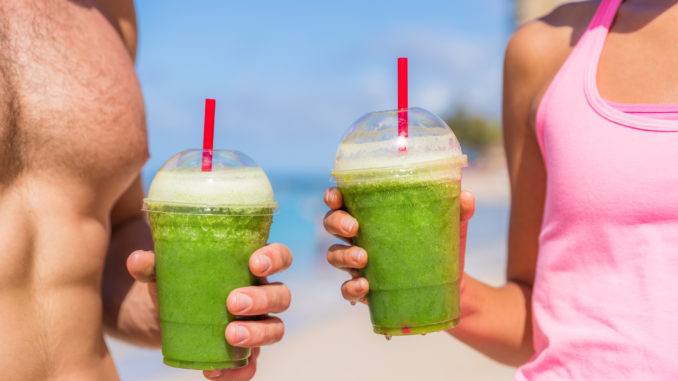 Man and woman with green shake