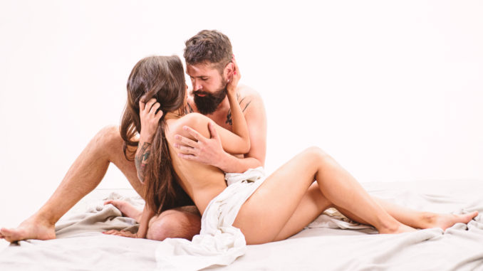 Couple lovers naked hug or cuddling in bed.
