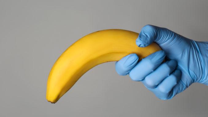 Doctor holding banana