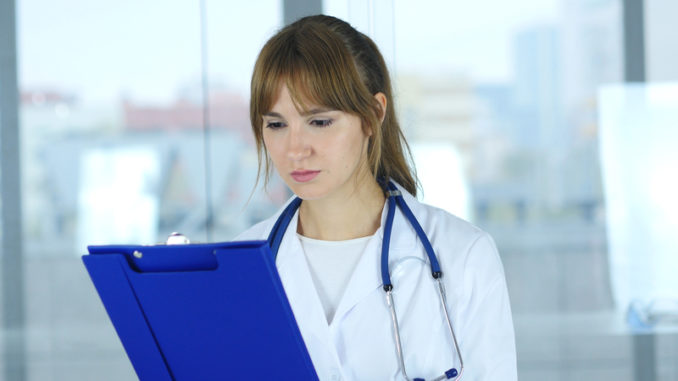 Close Up of Female Doctor Reading Medical Reports,4k , high quality