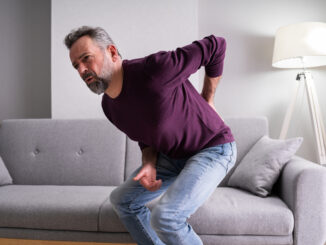 Older Senior Man With Back Pain Or Backpain