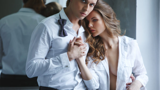 Lovers men and women in white shirt holding hands