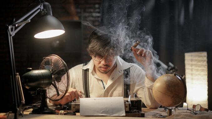 Stressed Man Smoking Cigar to Find Inspiration