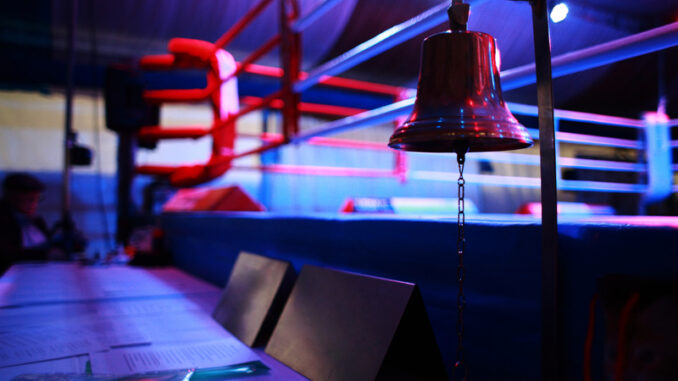 Empty boxing ring and bell
