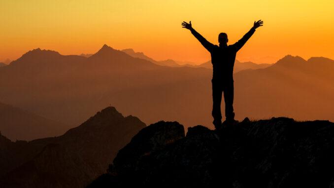 Happy celebrating winning success man at sunset