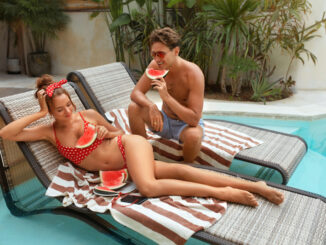 Couple At Pool Eat Watermelon
