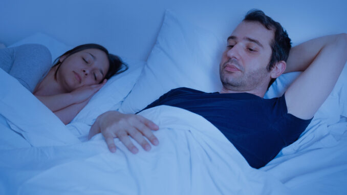 couple ling in bed