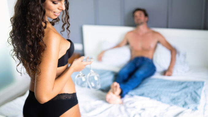 young couple passionate and playing in bedroom
