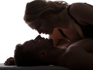 Young confident women seducing men in bed