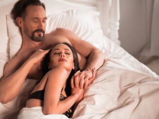 Adult couple in bed.
