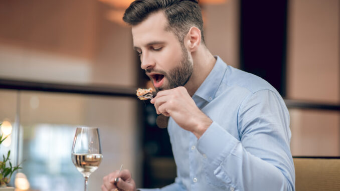 Man eating seafood at the restaurant